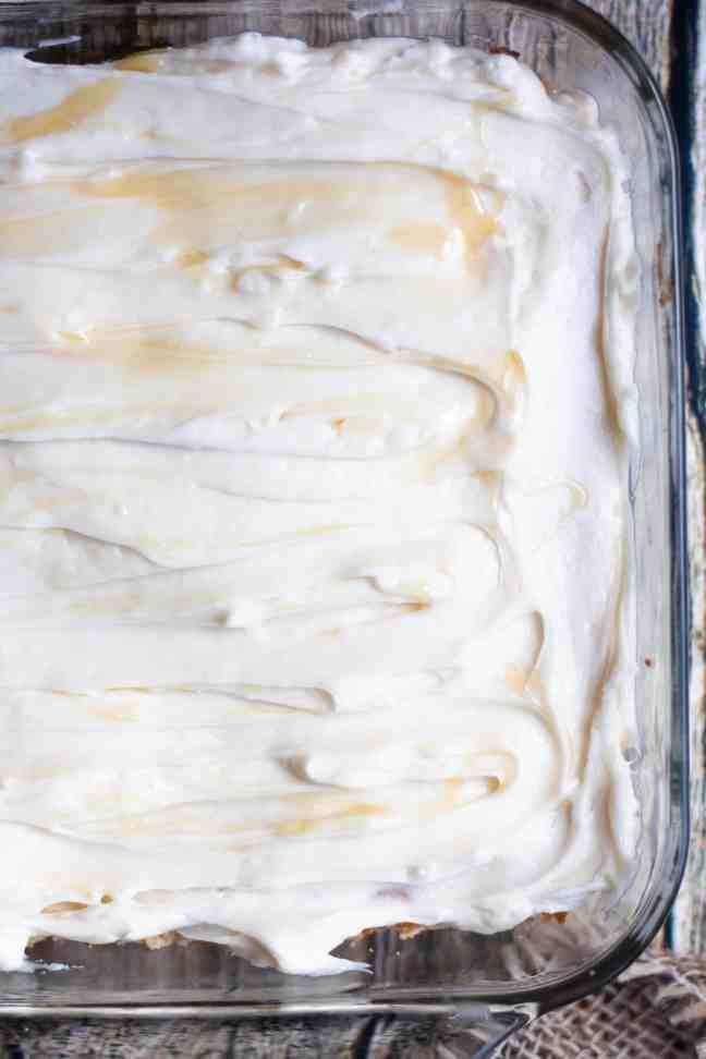 cake with frosting and honey
