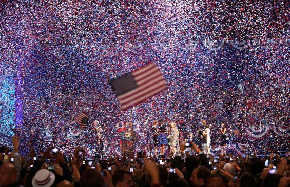 Confetti obscures the stage as U.S. President Barack Obama celebrates after winning the U.S. presidential election in Chicago, Illinois, November 7, 2012. REUTERS/Philip Scott- Andrews (UNITED STATES - Tags: POLITICS ELECTIONS USA PRESIDENTIAL ELECTION)
