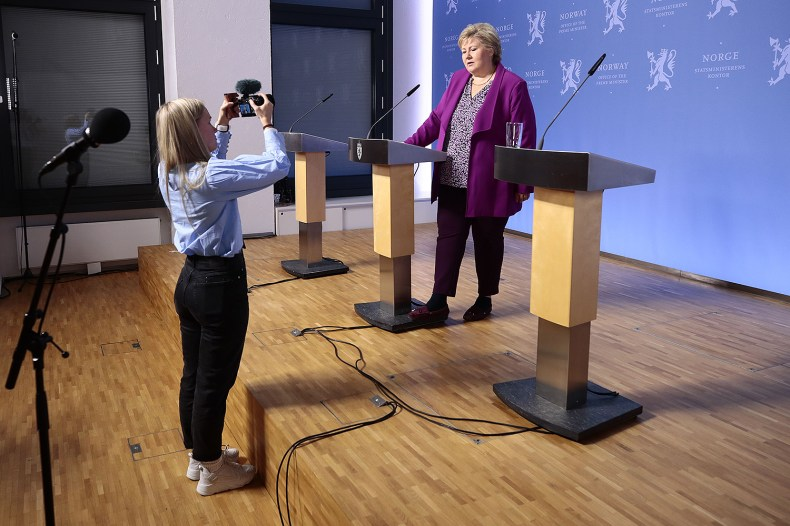 Prime Minister Erna Solberg gives a press conference in Oslo, Norway, on March 16, where children asked questions about the coronavirus.