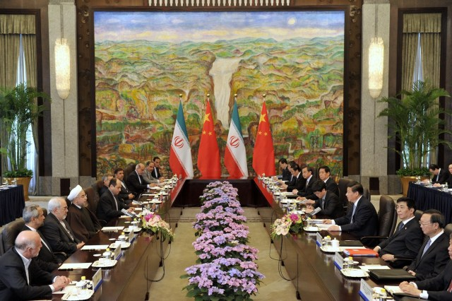 Iranian President Hassan Rouhani and China's President Xi Jinping attend a meeting in Shanghai on May 22, 2014.