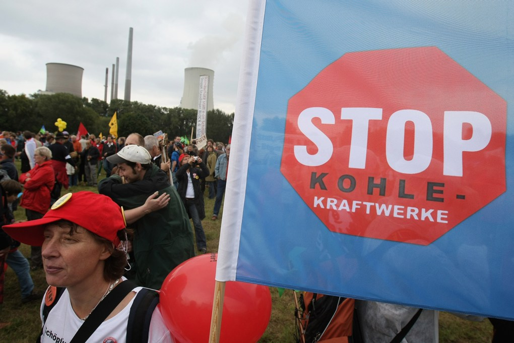 Protesters demonstrate in front of the combined hard coal and natural gas thermal power station of German energy giant E.ON