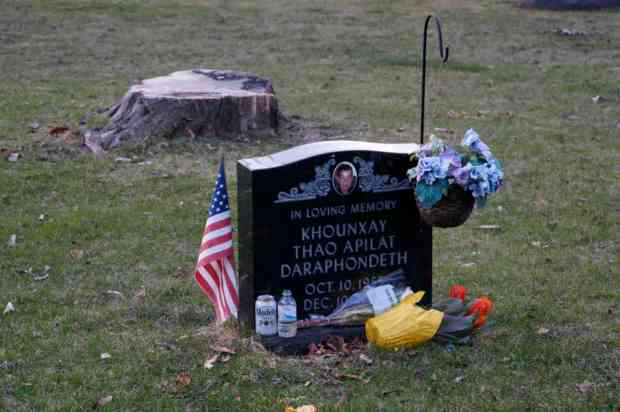 A graveside with several decoration violations.  Photo by William Cronon.