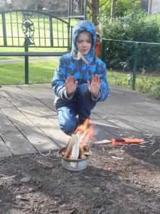 Kneeling at a fire