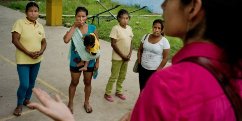 Center for International Forestry Research (CIFOR) scientist Elena Mejia talks to some Kichwa women. After CIFOR will meet with the rest of the villagers to inform them of CIFOR's findings, Napo Province, Ecuador.