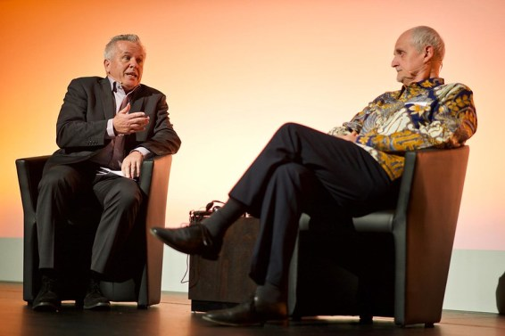 Two men in easy chairs engage in conversation