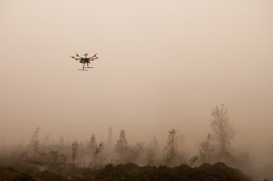 An Unmanned Aerial Vehicle (UAV) flies over burning peat. Outside Palangka Raya, Central Kalimantan. Photo by Aulia Erlangga/ CIFOR