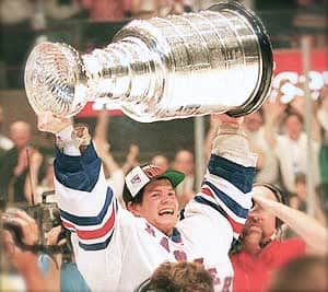 Mike Richter raises the Stanley Cup high. (Getty)