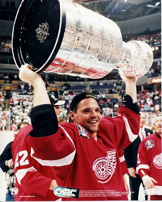 Joey Kocur raising the Cup up high (NHL)