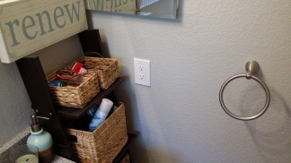 Moved the towel ring from where the baskets are now.