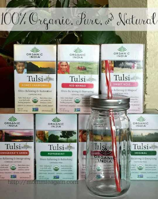 7 Organic India Tulsi Teas with glass can jar and straw in front