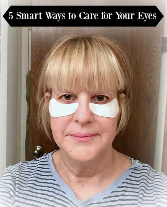 55 year old woman showing gel eye masks on under her eyes for overnight use