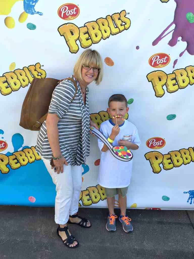 mom and son getting a post pebbles selfie Dallas Texas