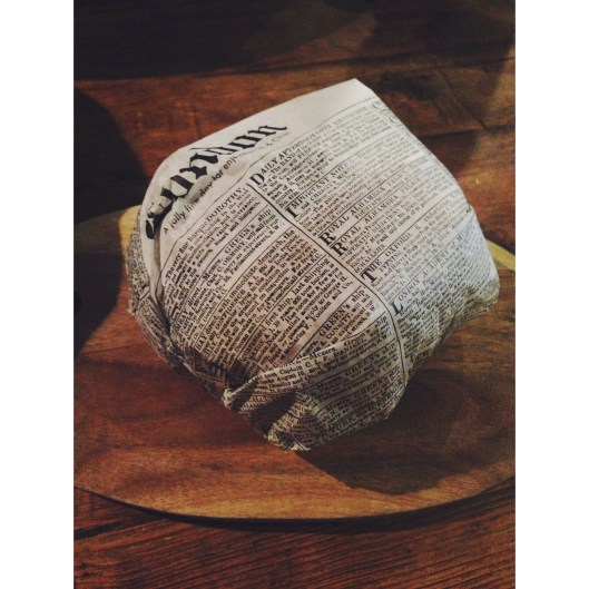 Wax paper, newspaper wrapping.