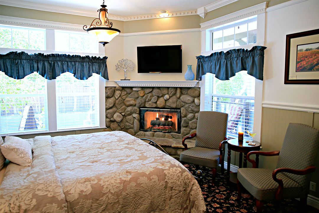 Tons of Natural Light and A River Rock Fireplace In Our Tercero Room