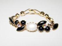 https://www.etsy.com/listing/472845558/vintage-bracelet-with-faux-onyx-auroral?