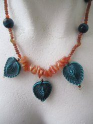 https://www.etsy.com/ca/listing/468418558/orange-and-teal-necklace-teal-leaves