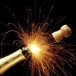 Popping champagne bottle with fireworks coming out of it