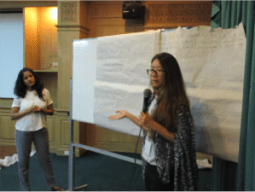 Justice Without Borders research fellows from National University of Singapore presenting on the common issues faced by Indonesian and Filipino migrant workers in Singapore.