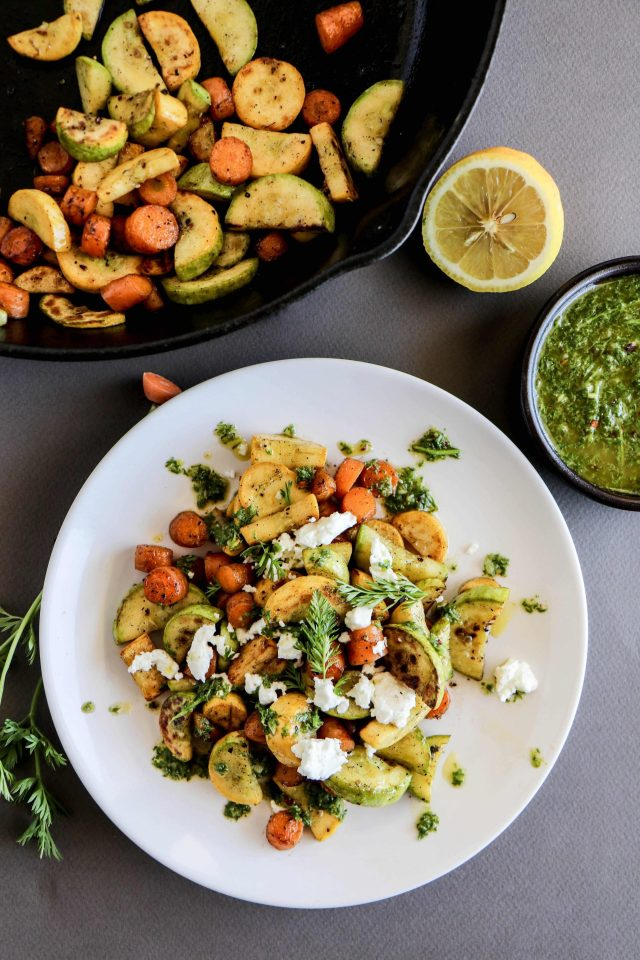 Carrots and squash pan-fried in a simple honey and olive oil glaze with a carrot top chimichurri sauce. You throw your carrot tops away? How dare you!