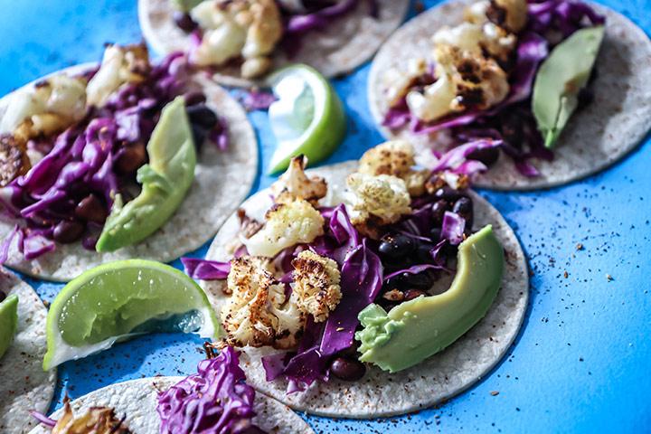Chili lime Cauliflower Tacos made with roasted cauliflower, chili powder, fresh lime, black beans and avocado. A vegan take on Taco Tuesday!