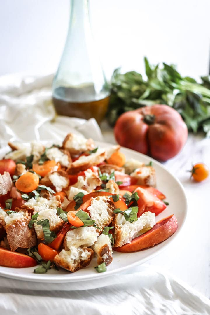 Summer Peach Panzanella Salad, a peachy summer salad with fresh tomatoes, ciabatta bread and summer peaches drizzled in a light olive oil dressing. Just peachy!