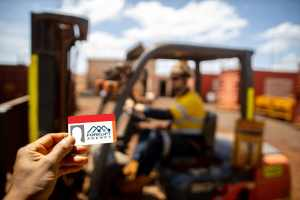 Forklift Training with Man Showing Forklift Licence