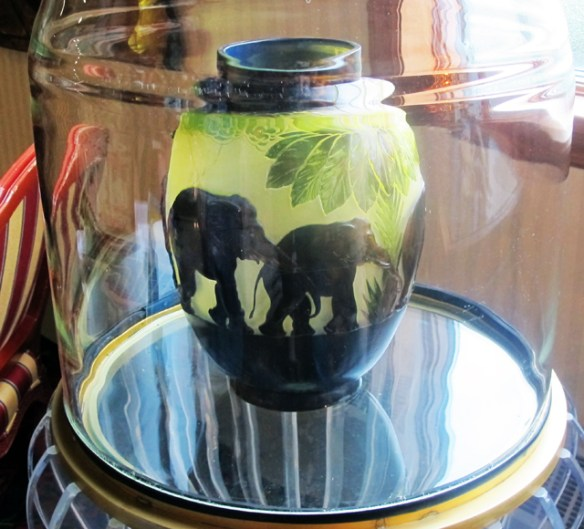 Outside, the elephant's eyes are open. Inside this priceless Galle vase, vase they are closed.