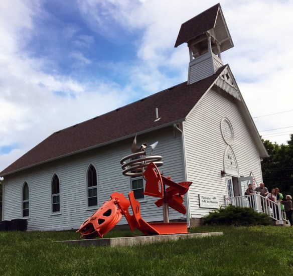 Mark di Suvero's unusual sculpture is a perfect reflection of the whimsy and history inside the Flatwater Folk Art Museum in Brownville, NE