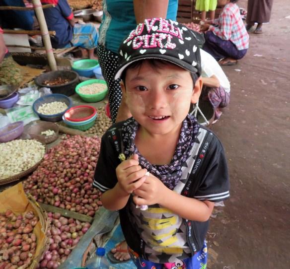 child in Myanmar market Amawaterways Cruise Myanmar