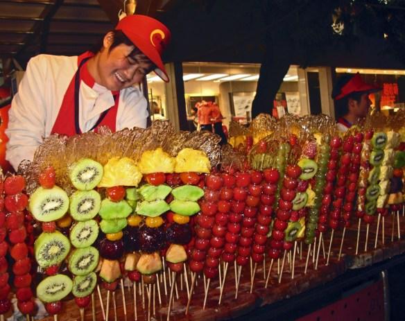 Beijing Night Market shy sugar coated fruits seller
