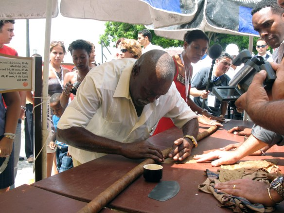 men rolling a giant cigar - The Perfect Cigar -Cuba's Gift to the World