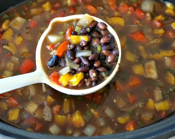 Turn on the crockpot and get ready for the big game this Sunday with our super-easy Slow Cooker Black Bean Soup recipe! Don't forget to download our FREE E-cookbook to find out what we're doing with the leftovers!