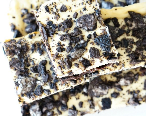 Oreo Cream Cheese Brownies - for those times when you can't decide if you want brownies, cookies or cheesecake. Why not have all three? It's Week 10 of #52WeeksofSweets!