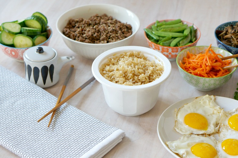 "Get your family involved in making this easy Korean Bibimbap recipe.  Inspired by the book ""Bee-bim Bop"", this recipe is a great mix and match meal allowing your family to combine their favorite ingredients.  Think of it as the original grain bowl!  A post from the popular Kitchen Stories series."