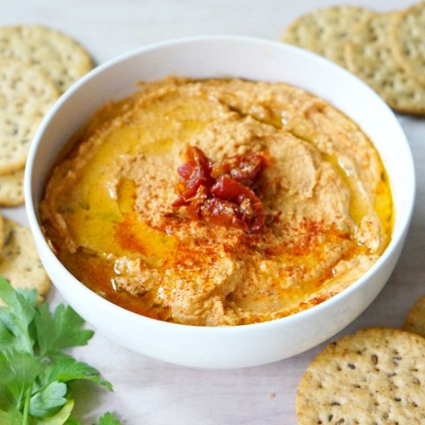 Inexpensive and super easy to make at home, this Homemade Sundried Tomato Hummus Recipe will be your new go-to appetizer and snack recipe.
