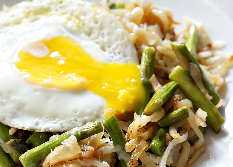 We're using up leftovers to make a hearty vegetarian breakfast!  This Asparagus & Egg Hash with caramelized onions, which I think makes the best hangover food, is also good for lunch or dinner.