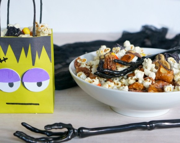 Little monsters everywhere will totally dig our DIY Monster Mash Treat Bags and snack mix.  Make sure to have plenty of snack mix on hand to avoid a monster riot! You've been warned!