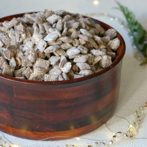 Chocolate Peanut Butter Muddy Buddies is our go to snack for the holiday season!  Deck the halls and reward your family afterwards with this perfect combination of chocolate, peanut butter and all things delicious!