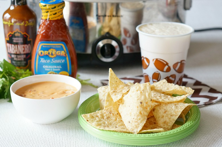 Slow Cooker Spicy Beer Queso is my answer to game time food.  Perfect for a crowd, easy to make, and totally worth blowing off your new year resolutions!