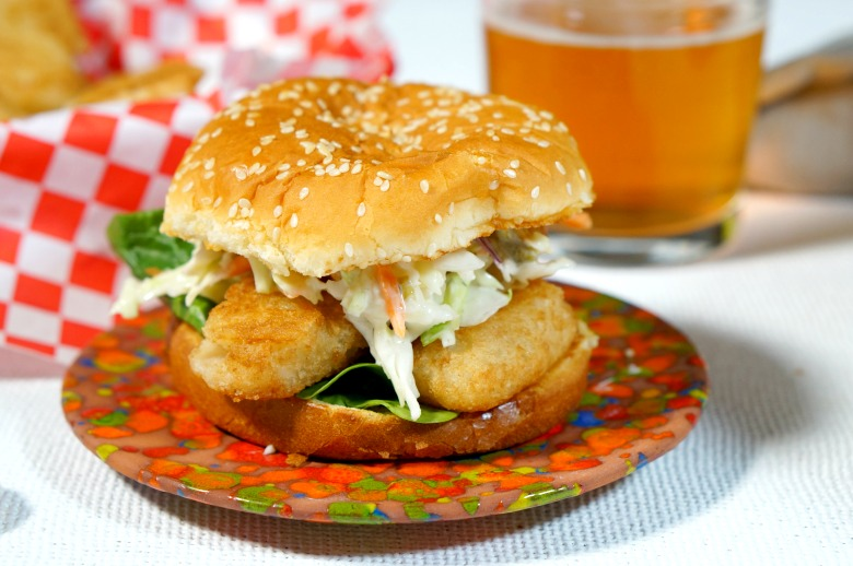 Light her up! Our Spicy Beer Battered Fish Burger packs some serious heat. Beer Battered Fish Fillets are stacked on hot sauce buttered buns and topped with a jalapeño slaw.