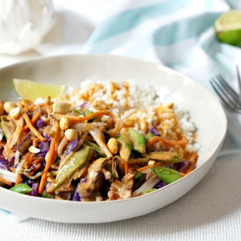 Colorful, flavorful and easy. These Thai Peanut Veggie Rice Bowls are freaking delicious!  Mix and match your favorite veggies and add some grilled chicken or meat if you like.  You'll wanna use the extra Thai Peanut Sauce on EVERYTHING!