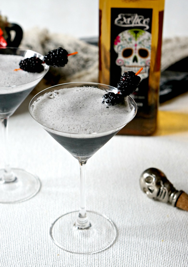 Squid ink paste lends this Midnight Margarita it's color and a perfect salty-brininess in this black-as-night Halloween party cocktail.