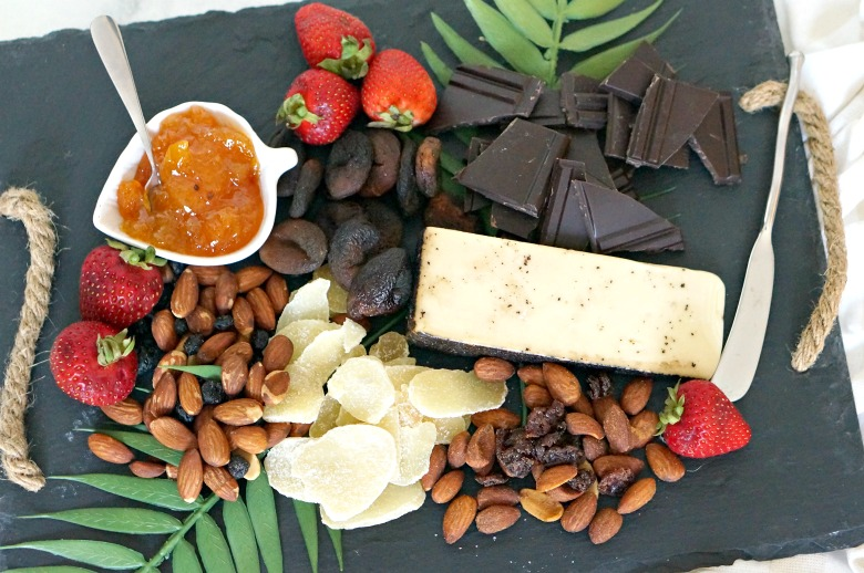 Step up your snacking game with this fancy (but not too fancy) Almonds & Fruit Snack Board.  Serve this Snack Board to guests as a mid-day treat or as a post-dinner sweet and salty dessert with drinks.