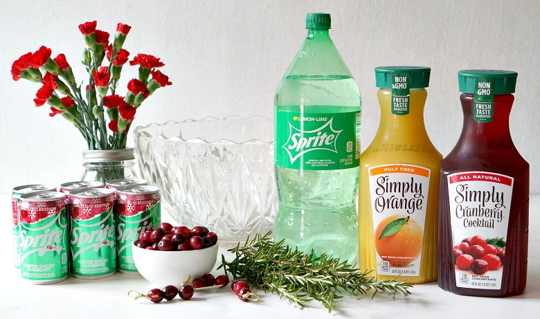 Need an all-purpose beverage for your holiday get-togethers?  Our Cranberry Spiced Holiday Punch is easy to make and looks beautiful with homemade flower and fruit ice cubes.