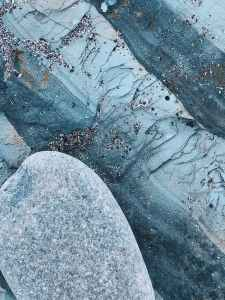 rough frozen surface under old stone
