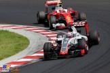 Romain Grosjean (Haas F1 Team, VF16) and Kimi Räikkönen (Scuderia Ferrari, SF16-H)