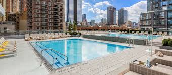 enjoy your rooftop deck and swimming pool at your condos for rent no credit check