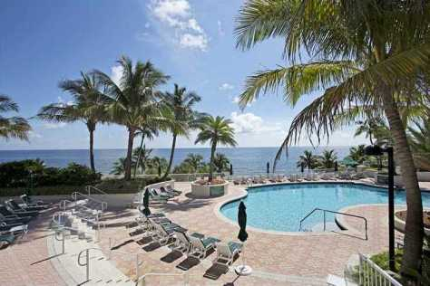 View of the oceanfront pool at L'Hermitage a luxury Fort Lauderdale condominium