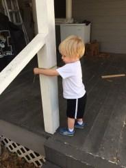 Levi enjoying the measuring tape.