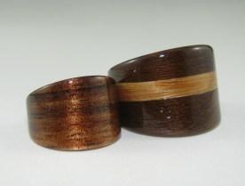 Hawaiian Koa ring with a reddish hue and a Black Walnut ring with a Eucalyptus band